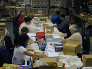 Warehouse team packing a Direct Mail Job